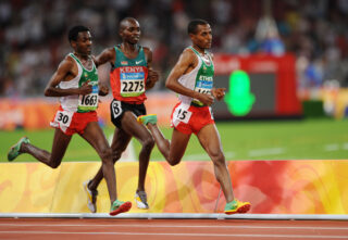 Ethiopia's Kenenisa Bekele (R) runs to win ahead of compatriot Sileshi Sihine (L) and Kenyan Micah Kogo during the men's 10,000m final at the National Stadium as part of the 2008 Beijing Olympic Games on August 17, 2008. Kenenisa Bekele of Ethiopia defended his 10,000m title medal at the Olympics on Sunday, producing a devastating burst of speed on the last lap to see off any pretender. Bekele finished in a new Olympic record of 27min 01.17sec, with compatriot Sileshi Sihine claiming silver - as he did at the Athens Games in 2004 - in 27:02.77. Kenyan Micah Kogo ensured there was no Ethiopian cleansweep, taking bronze in 27:04.11. AFP PHOTO / FABRICE COFFRINI